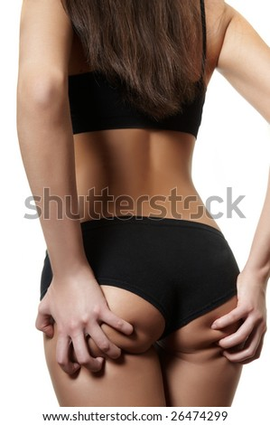girl has seized itself by hands for bottom - stock photo
