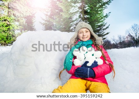 Girl have fun with snowball fight winter outdoor - stock photo