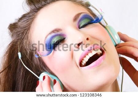 Girl Having Fun Listening to Music on Headphones - stock photo