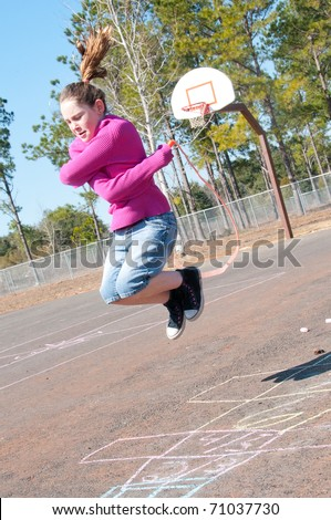 girl having fun on playground - stock photo