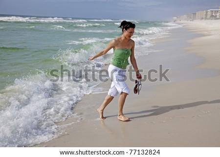 Girl having fun on the beach - Florida, USA - stock photo