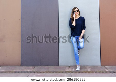 Girl having fun outdoors and calling smart phone, lifestyle. Big smile. - stock photo