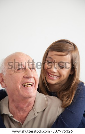 girl having fun with her grandfather