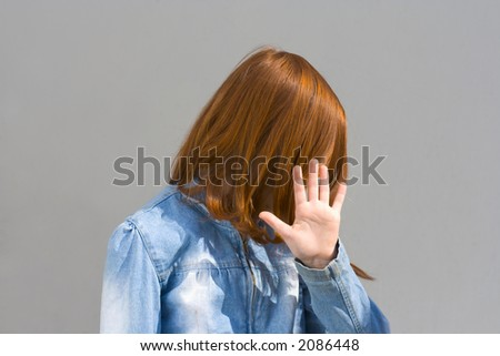 Girl hides her face - stock photo
