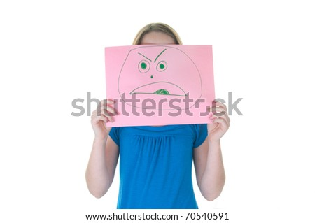 girl hiding behind angry face, part of emotional series - stock photo