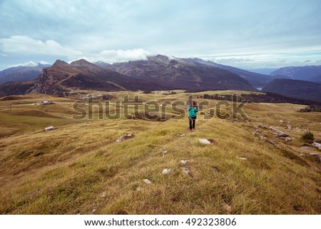girl hiker at the mountains Dolomites, Italy. Valley View
