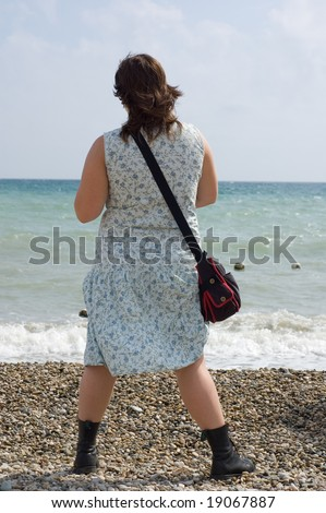 girl hippy on the coast in dress and high shoes - stock photo