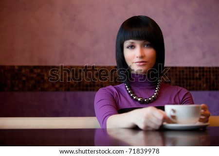 girl hold cup of coffee in hand - stock photo