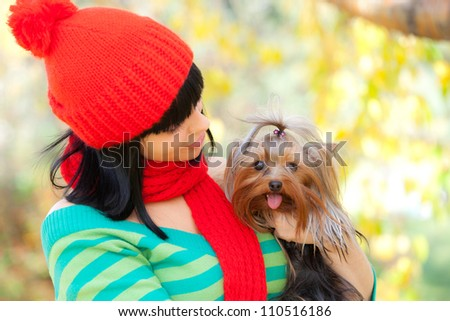 girl hold small dog in her hands - stock photo