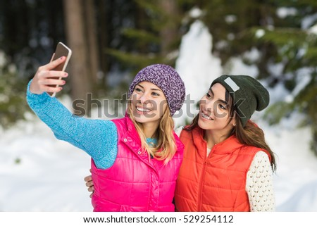 Girl Hold Smart Phone Camera Taking Selfie Photo Snow Forest Young Woman Couple Outdoor Winter Pine Woods