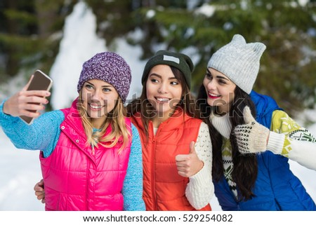 Girl Hold Smart Phone Camera Taking Selfie Photo Snow Forest Young Woman Group Outdoor Winter Pine Woods