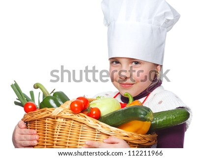 girl holding a basket full of healthy vegetables