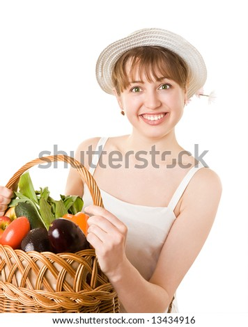 Girl holding a basket of delicious fresh vegetables. Isolated on white.
