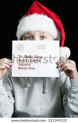 Girl holding a christmas letter for santa - stock photo