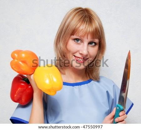 Girl holding a fruit of sweet pepper. - stock photo