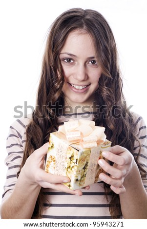 Girl holding a gift in packing - stock photo