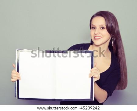 girl holding a magazine - stock photo
