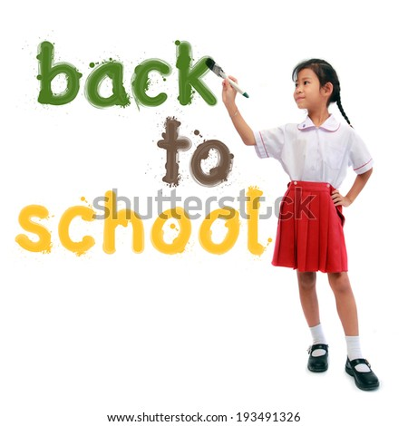 girl holding a paint brush painting back to school text, isolated on white background - stock photo