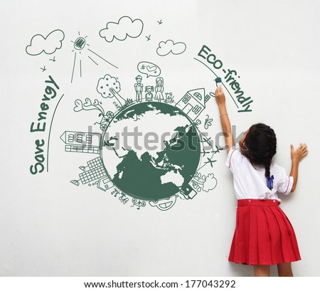 Girl holding a paint brush painting on a white wall with creative drawing eco friendly, save energy - stock photo