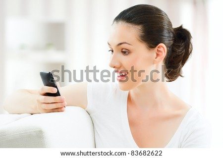 girl holding a phone in the home