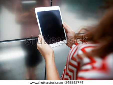 girl holding a plate metal background  - stock photo