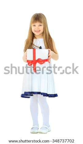 girl holding a present and smiling - stock photo