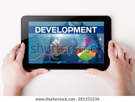 Girl holding a tablet pc which a man presses the virtual screen with text development. Technology, business, internet, concept. - stock photo