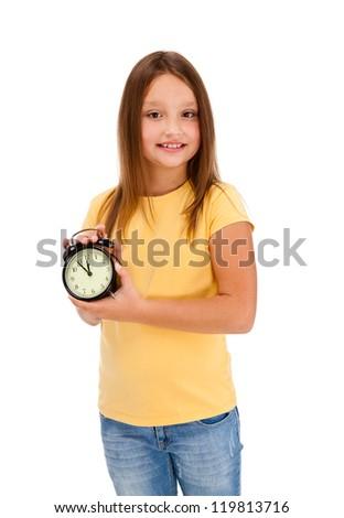 Girl holding alarm-clock isolated on white background - stock photo