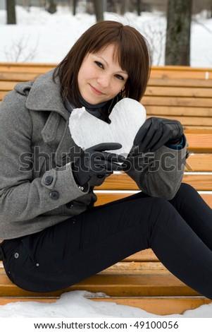 Girl holding an ice heart - stock photo