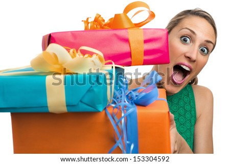 girl holding and offering gifts in white background - stock photo