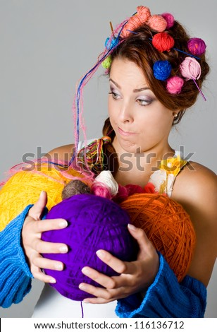 Girl holding balls of yarn