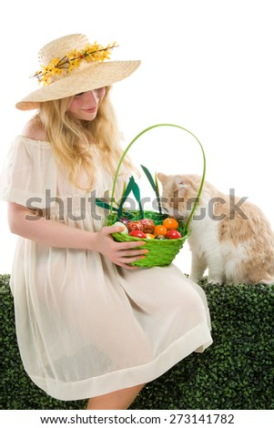 girl holding basket of colored eggs for easter