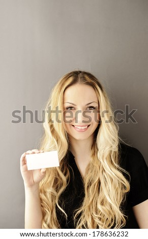 Girl holding blank membership card  - stock photo