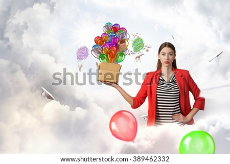 Girl holding box in hand - stock photo