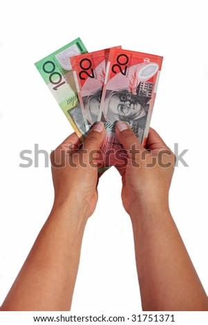 Girl holding dollar notes against white background - stock photo