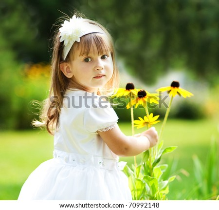 girl holding flowers - stock photo