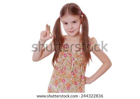 girl holding golden vintage old key - stock photo
