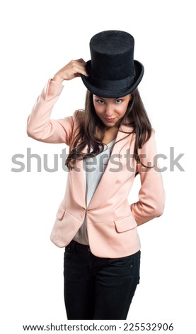 Girl holding hat with one hand isolated on white background
