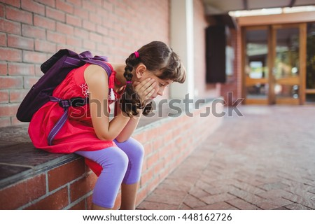 Girl holding her cheek with a desperate looking - stock photo