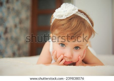 girl holding her hands on cheeks - stock photo