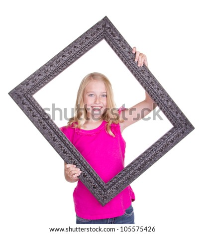 Girl holding large frame around face, isolated on white