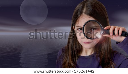 Girl holding magnifying glas on moon light