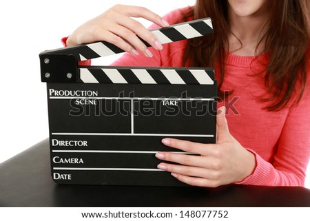 girl holding movie slate clapboard