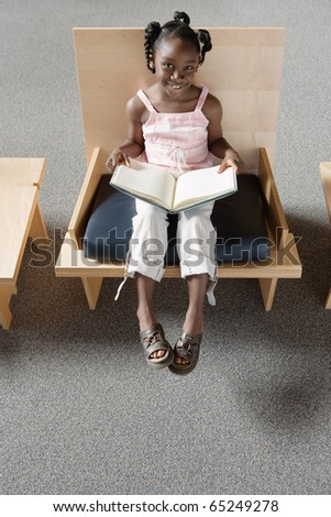 Girl holding open book - stock photo