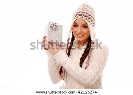 Girl holding present on white background - stock photo