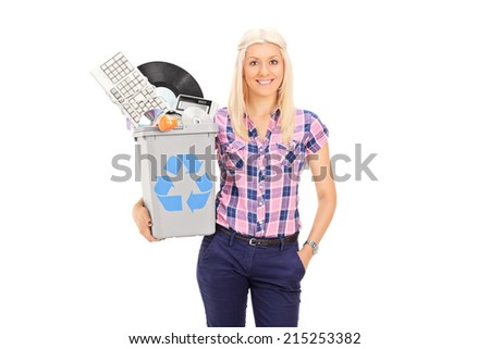 Girl holding recycle bin full of old accessories isolated on white background - stock photo