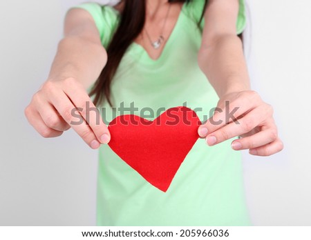 Girl holding red heart  - stock photo