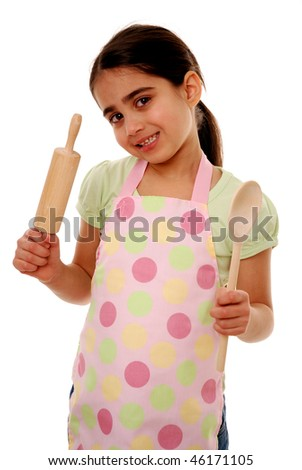 Girl holding rolling pin and wooden spoon isolated on white