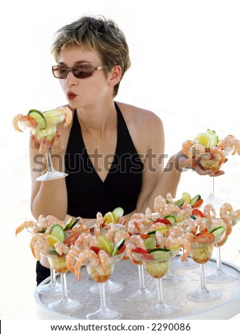 Girl holding shrimp cocktails isolated - stock photo