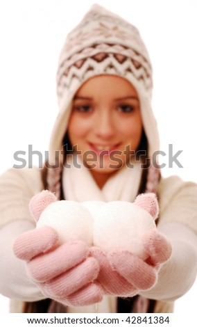 Girl holding snowballs (snowball in focus) on white background - stock photo